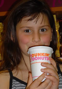 Helena with Dunkin Donuts coffee