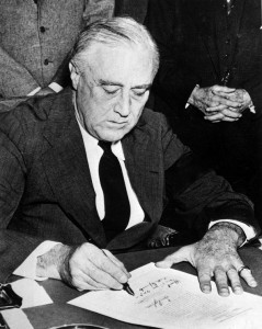 Franklin_Roosevelt_signing_declaration_of_war_against_Japan